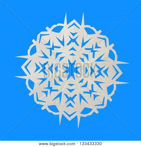 One paper white snowflake lie on blue background