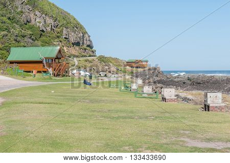 STORMS RIVER MOUTH SOUTH AFRICA - FEBRUARY 28 2016: Unidentified tourists in front of chalets at the rest camp at Storms River Mouth