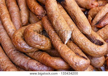 Homemade fresh meat delicacies (sausages) at a farmers' Sunday market.