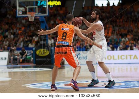 VALENCIA, SPAIN - JUNE 7th: Sergi Llull with ball and Diot during 3rd playoff match between Valencia Basket and Real Madrid at Fonteta Stadium on June 7, 2016 in Valencia, Spain