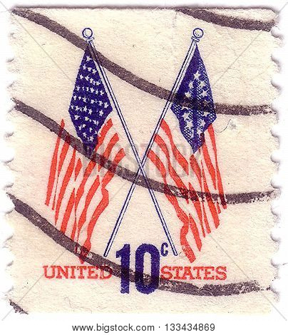 UNITED STATES - CIRCA 1973: A postage stamp printed in the United States features waving US flag circa 1973