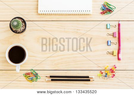 Flat lay office desk with notebooks smart phonepenpencilpaperclippincactus and a cup of coffee. Top view with copy space. Business concept