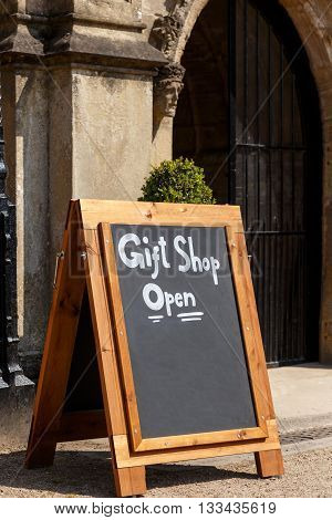 NEWSTEAD ABBEY JUNE 5: A chalk board A-sign stating Gift Shop Open. At Newstead Abbey Nottinghamshire England. On 5th June 2016.