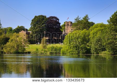 NEWSTEAD ABBEY JUNE 5: View of Newstead Abbey over the Garden Lake visitors on the lawn. At Newstead Abbey Nottinghamshire England. On 5th June 2016.