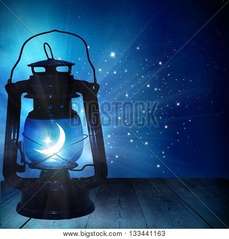 Ramadan Kareem background.Ramadan lantern on wooden  table
