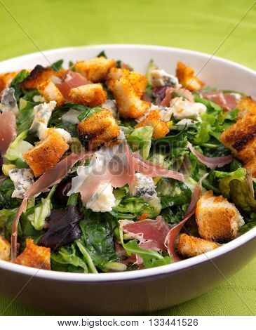 French Provencal Salad with green salad bacon croutons and blue cheese. Close up vertical shot