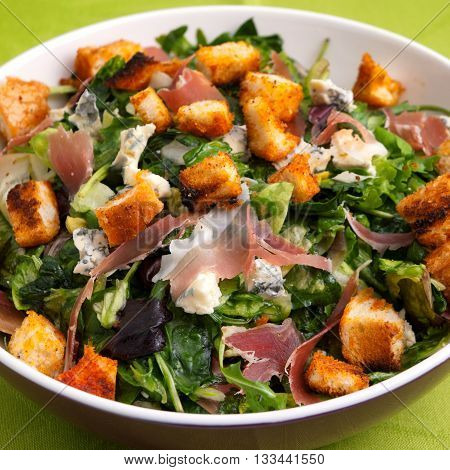 French Provencal Salad with green salad bacon croutons and blue cheese. Close up square shot