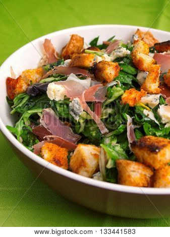 French Provencal Salad with green salad bacon croutons and blue cheese. Vertical shot