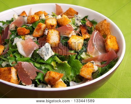 French Provencal Salad with green salad bacon croutons and blue cheese. Close up horizontal shot