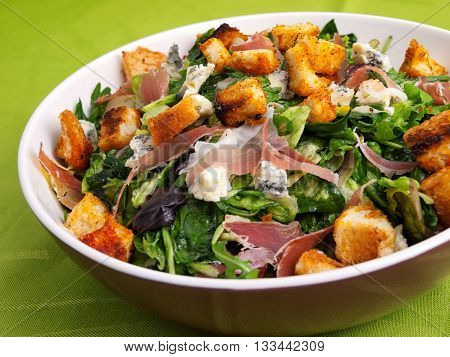 French Provencal Salad with green salad bacon croutons and blue cheese. Horizontal shot