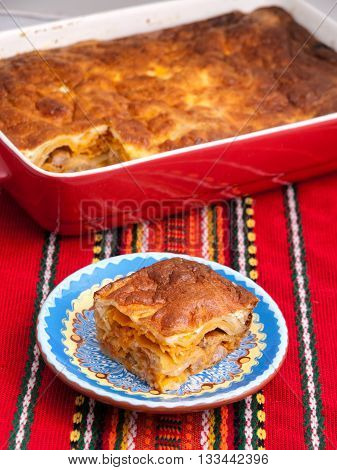 Italian lasagna with ham and cheese. Vertical shot