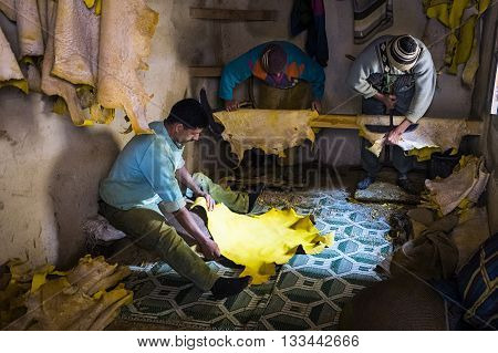 Fez Morocco - April 11 2016: Tree man working in a tannery in the city of Fez in Morocco.