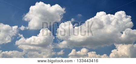 Summer clouds flying in the deep blue sky