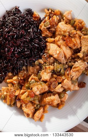 Turkey with capers and raisins over wild rice