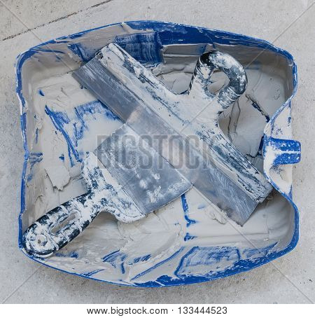 palette-knife in hand isolated on a white background