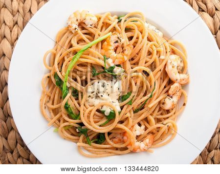 Italian spaghetti pasta with shrimps and cream. Shot from above horizontal macro shot