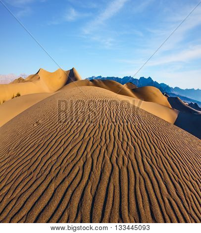 Magnificent sandy waves on dunes. Early morning in Death Valley, California