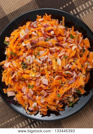 Healthy salad from grated carrots ham and dressing. Shot from above full length view