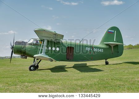 Yalutorovsk, Russia - May 24. 2008: AN-2 airplane with paratroopers onboard prepares for take-off. Sport aerodrome