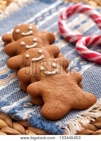 Row of homemade gingerbread men cookies. Vertical shot