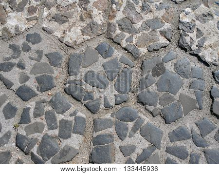 Ancient cobblestone street. Cobblestone laid by hand.