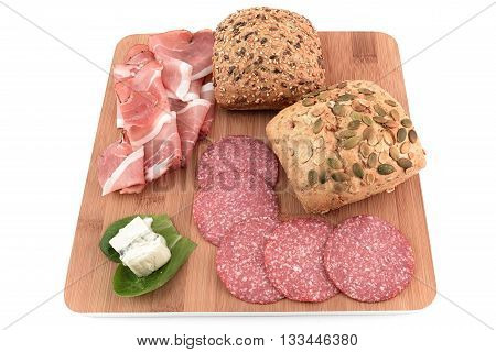 two cereal bread, speck, salami and gorgonzola