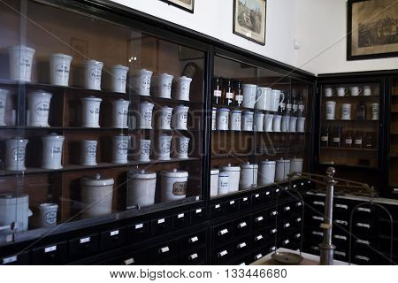 Empty chemical bottles in old vintage pharmacy