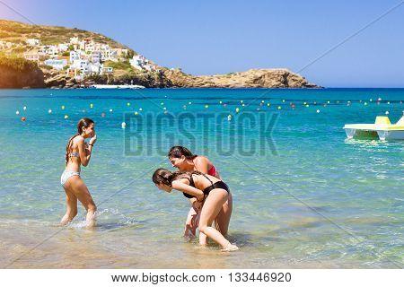 Greek Girls In Bikinis Playing In Sea Water, Bali, Crete