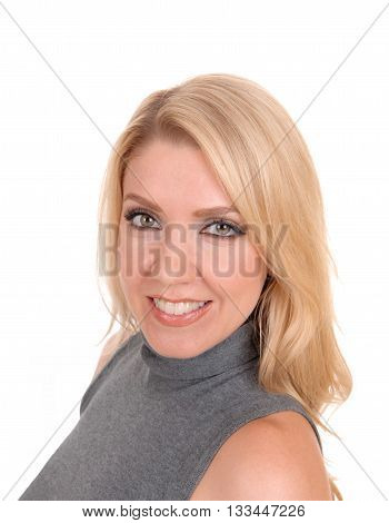 A closeup image of a lovely blond woman in a gray sweater looking into the camera isolated for white background.