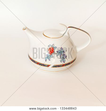 White teapot with a pattern for making tea