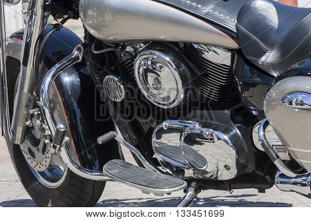 motorcycle metal and chrome engine parts in closeup