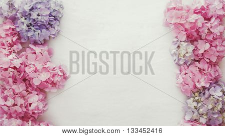 Vintage fresh hydrangea floral background. Natural hydrangea flowers  on a rustic wood background. Top view, vintage toned image, blank space