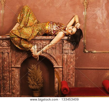 portrait of beauty sensual young woman in oriental style luxury room
