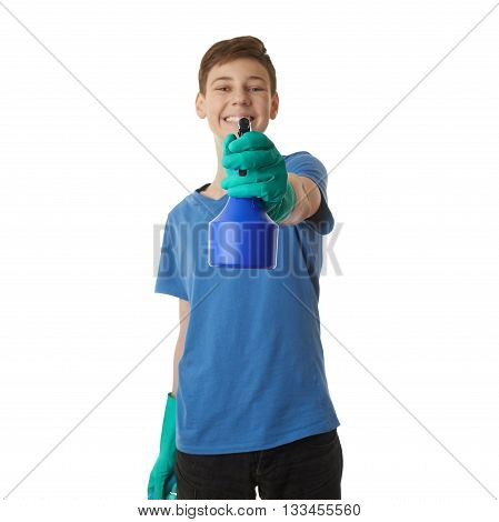 Cute teenager boy in blue T-shirt and green rubber gloves with spray tool over white isolated background, half body, cleaning concept