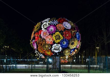 LYON, FRANCE - MAY 24, 2015: This sculpture consists of eighty-five plastic flowers about one meter in diameter forming a spherical crown.
