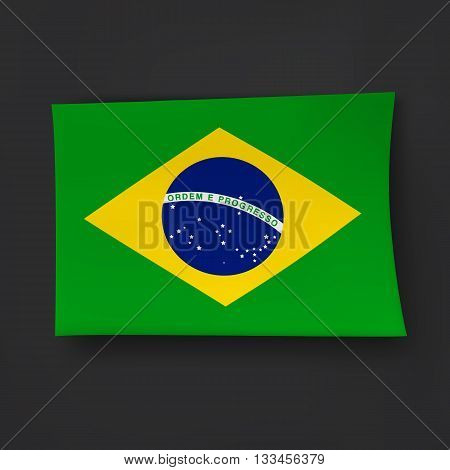 Brazilian flag on the black background with shadows.