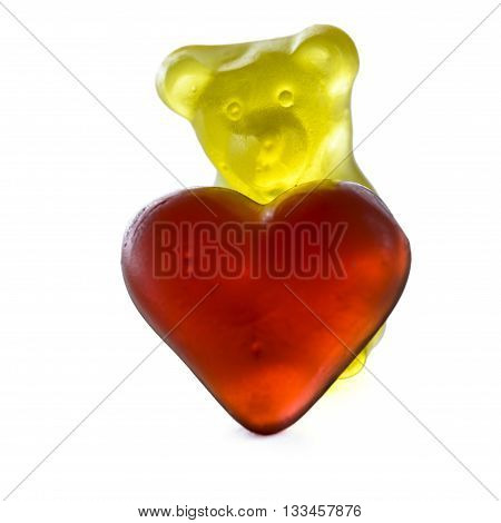 gummy bear with red gummy heart isolated on white background