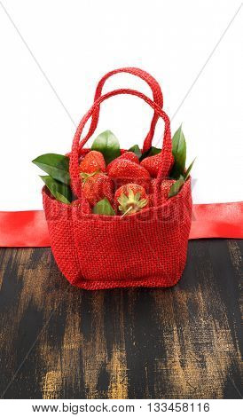 Basket with strawberries. Strawberries in a basket. Isolated on white background. Red Basket.
