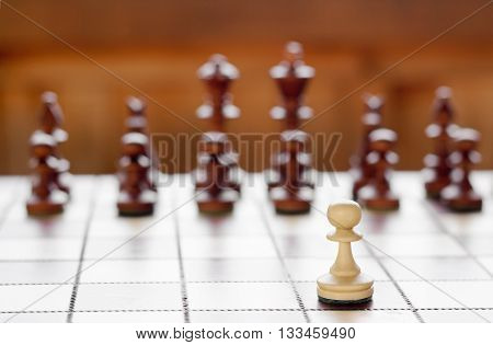 Chess on chessboard, one against all concept image