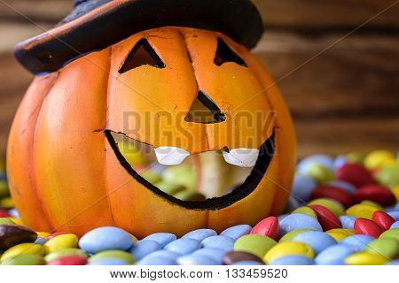 halloween pumpkin with colored sweet chocolate candy