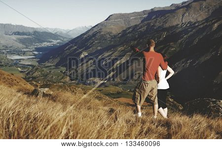 Couple Looking Afar Where Mountain Lake Are Concept