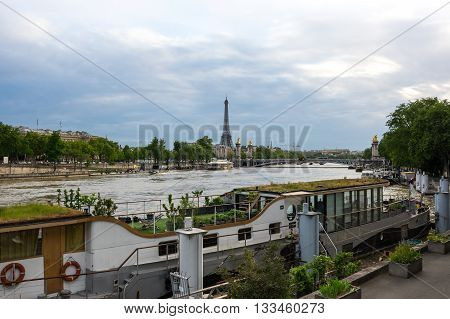 Tour Eiffel and Pont Alexandre III bridge over the river Seine in the dusk Paris France