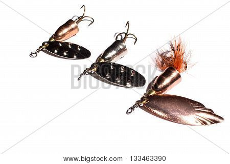 Fishing spinner lures on the white background