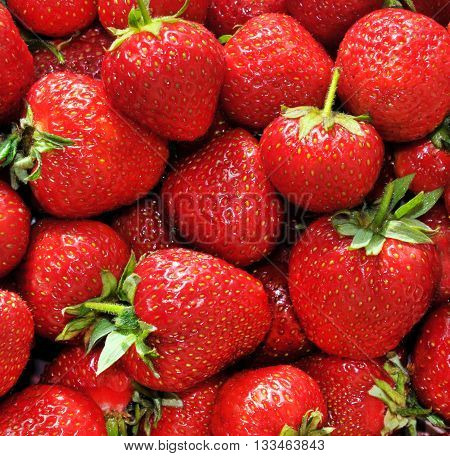 Red ripe juicy strawberries closeup, background, full frame
