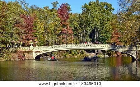 NEW YORK CITY - OCT 27: 2013:  View of the Bow Bridge at Central Park in New York City.  The first cast-iron bridge in the Park (second oldest in America), the bridge was built between 1859 and 1862.
