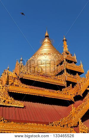 Shwezigon Pagoda is one of the biggest religious places in Bagan. Vertical shot