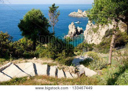 Small beautiful lagoon on Corfu island Greece. Steps on foreground. Horizontal shot