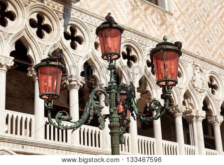 Close up of Dodges Palace in Venice Italy. Street lamp on foreground