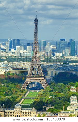 Eiffel tower as seen from Montparnasse Tower. La Defense business district seen on background. Close up