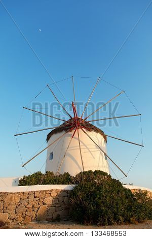 Windmill in front of a blue sky in Mykonos island Greece at sunset. Vertical shot.